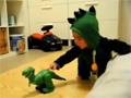 Baby scared by Dinosaur video